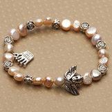 Pearls for Girls armband med pärlor och ängel